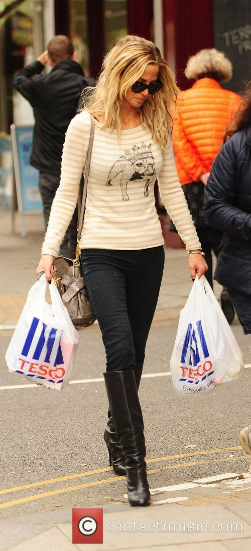 Sarah Harding returns home from Tesco