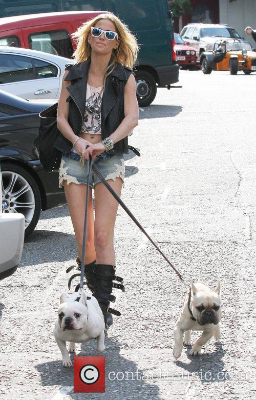 Sarah Harding taking her out dogs for a...