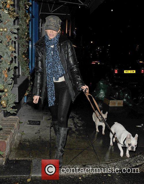 Sarah Harding walking her dogs late at night,...