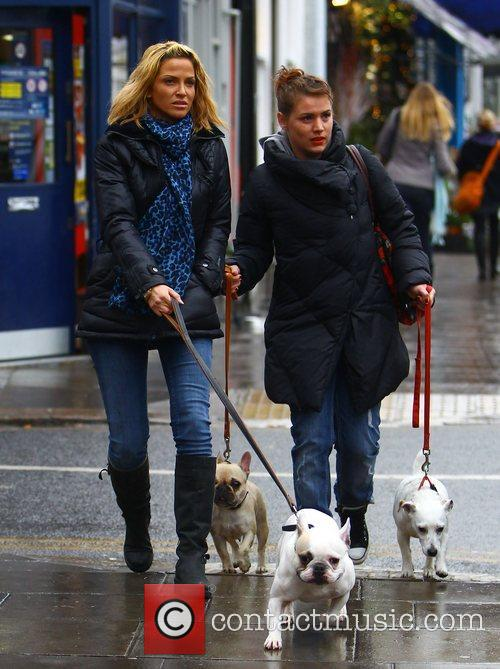 Sarah Harding and a friend walk their dogs...