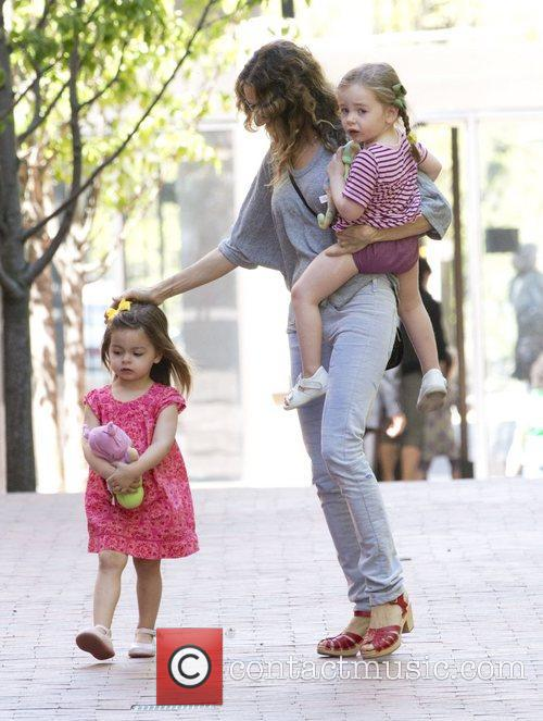 Sarah Jessica Parker collects her twin daughters Marion...