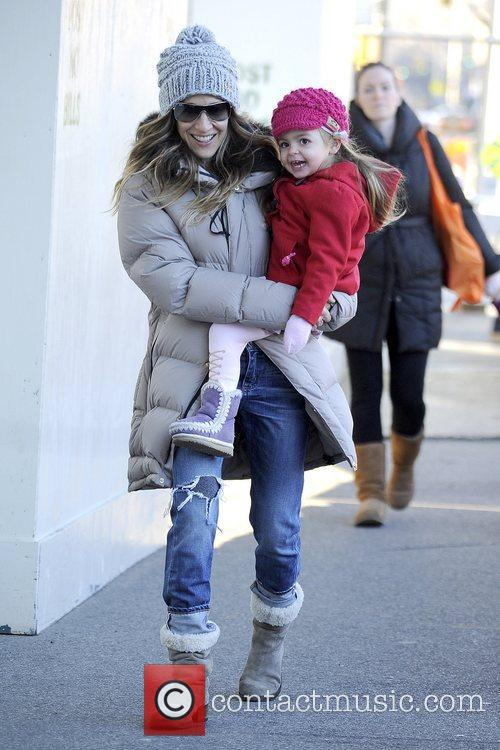 Sarah Jessica Parker walks her twin daughters to...