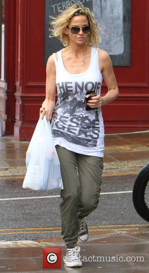 Sarah Harding gets caught in the rain while...