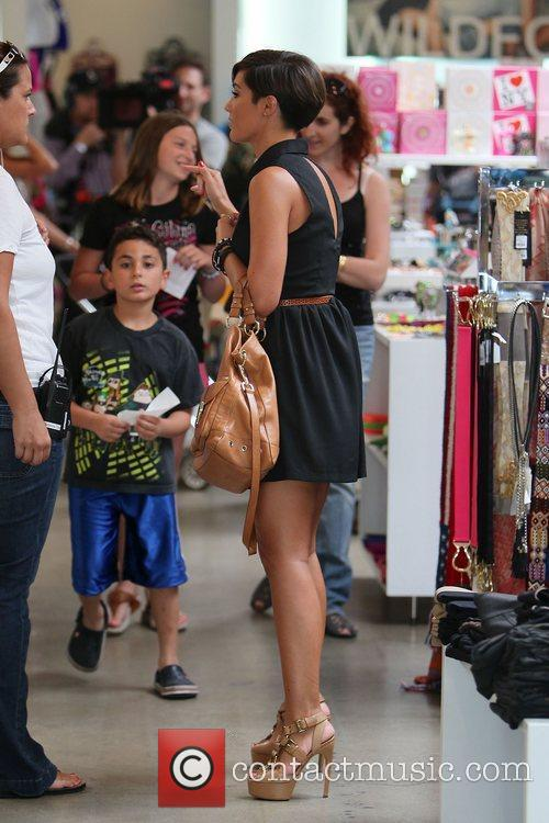 Of The Saturdays shopping on Robertson Boulevard. They...