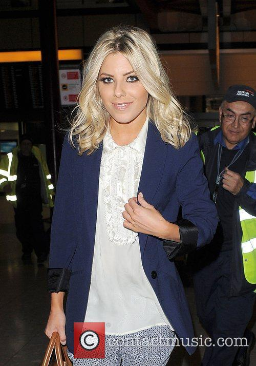 mollie king arrives at heathrow airport with 3894543