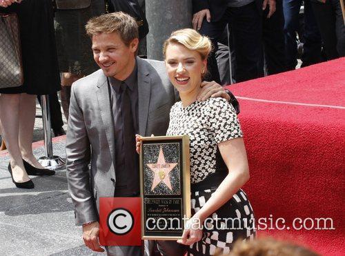 Scarlett Johansson, Jeremy Renner  Scarlett Johansson is...