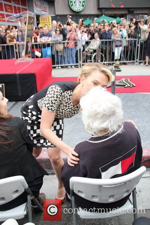 Actress Scarlett Johansson kisses her grandmother as she...