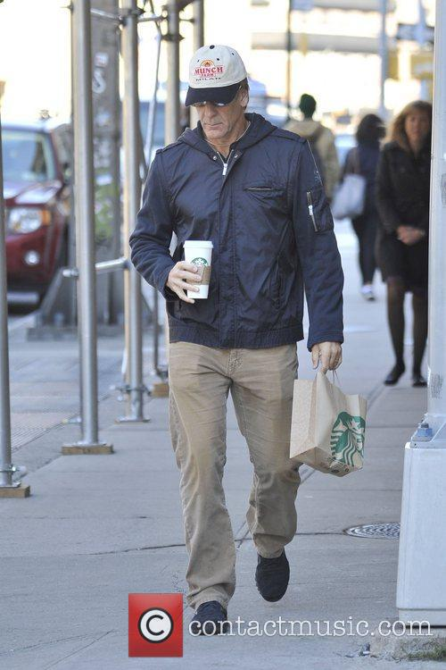 Seen out and about holding his Starbucks coffee