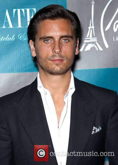 Scott Disick walks the red carpet at Chateau...