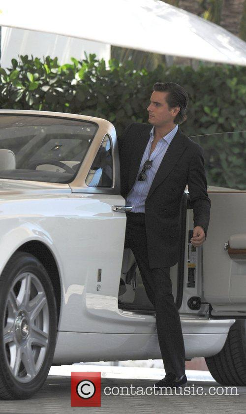 Scott Disick taking a ride in a Rolls...