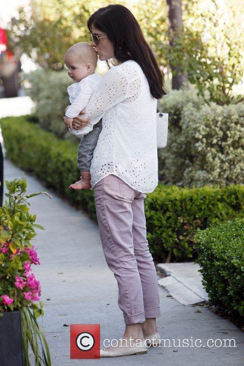 Selma Blair carries her son Arthur while out...