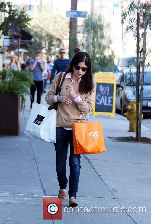 Actress Selma Blair carries shopping bags back to...