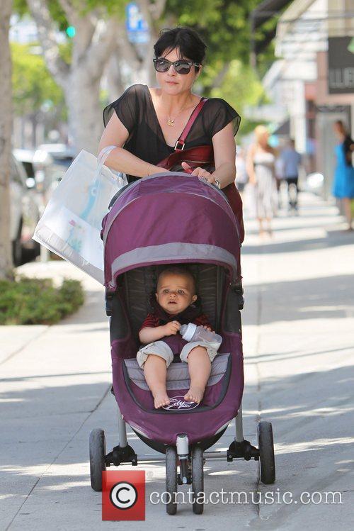 Seen with son Arthur Saint Bleick shopping at...