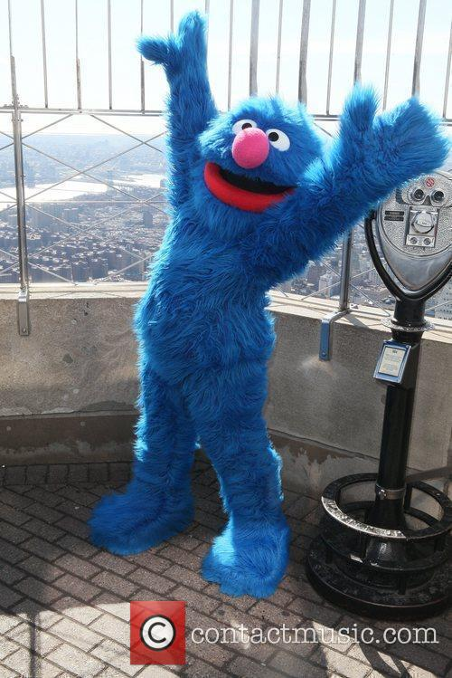 Sesame Street characters visit the top of the...