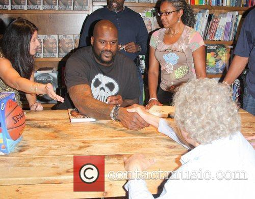 Greets fans and signs copies of his book...