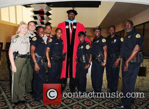 Shaquille O'Neal and Miami police officers Shaquille O'Neal...