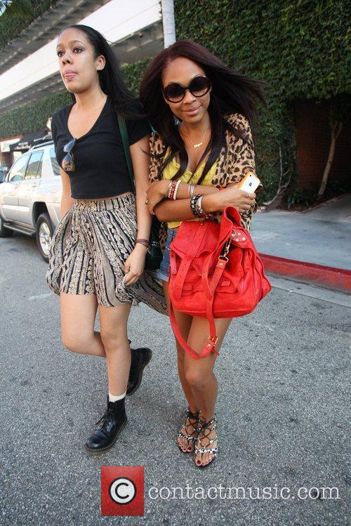 Exits Beverly Hills Nail Design with a friend.