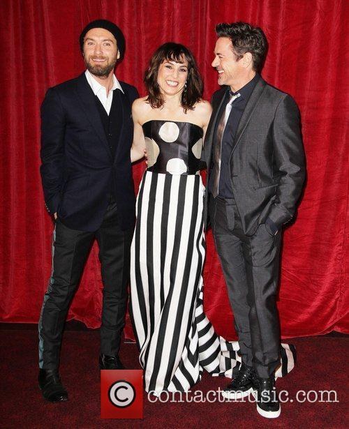Jude Law, Noomi Rapace and Robert Downey Jr 9