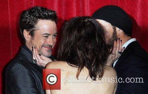 Robert Downey Jr, Jude Law and Noomi Rapace 1