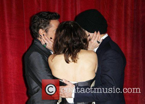 Robert Downey Jr, Jude Law and Noomi Rapace 4