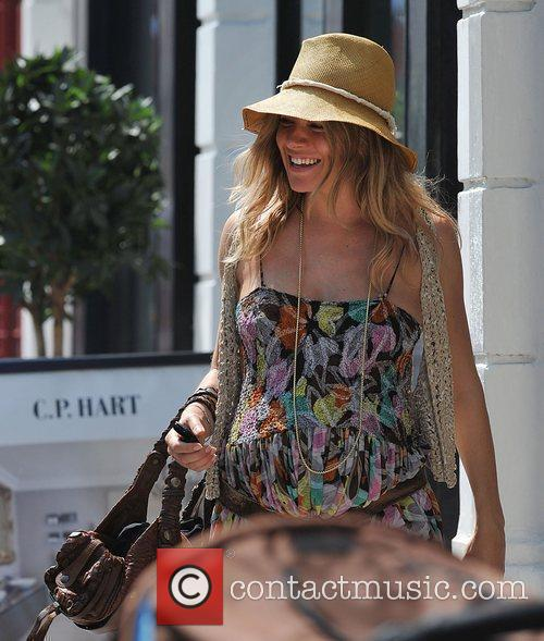 Pregnant Sienna Miller out and about in Primrose...
