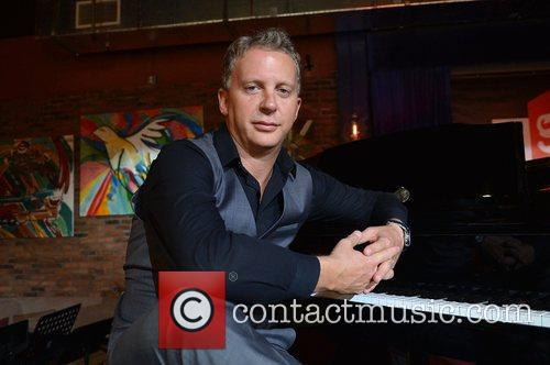 Singer/songwriter Simon Richards poses for a picture during...