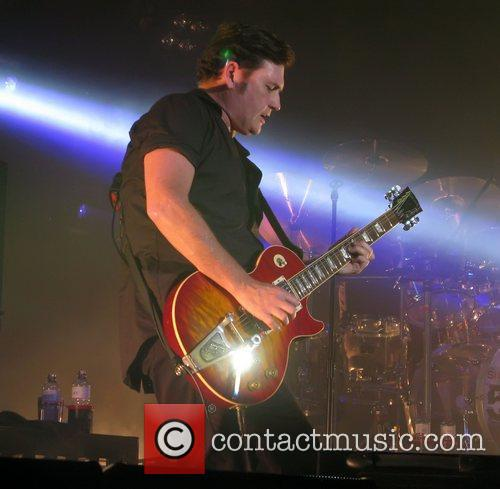 Charlie Burchill Simple Minds performing at The Roundhouse...