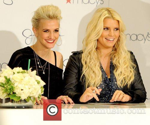 The Simpson sisters attend an autograph signing at...