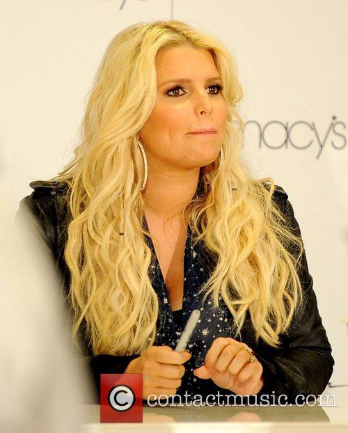 Jessica Simpson The Simpson sisters attend an autograph...