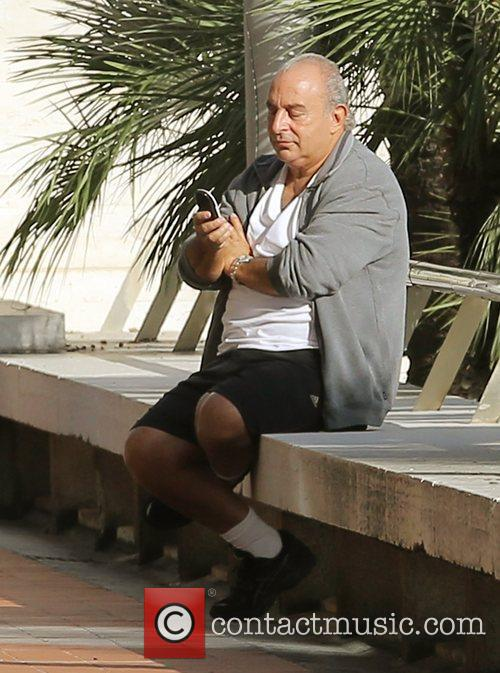 Sir Philip Green using his mobile phone by...