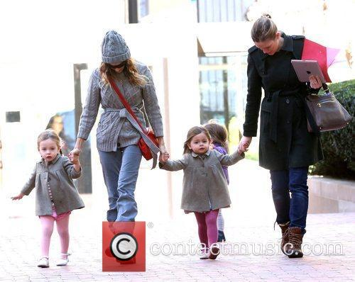 Picking up her twin daughters Marion Broderick and...