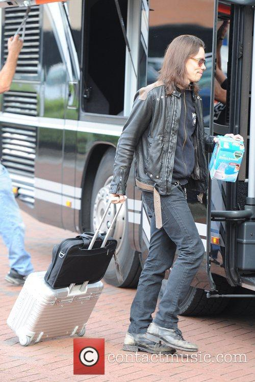 Myles Kennedy leaves his Manchester hotel carrying a...