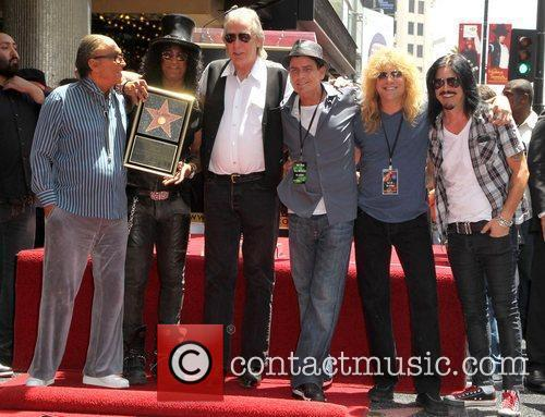 Robert Evans, Charlie Sheen, Gilby Clarke, Jim Ladd, Slash and Steven Adler