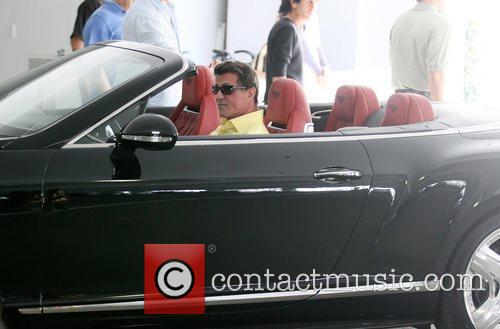 Sylvester Stallone drives his new Bentley GT convertible...