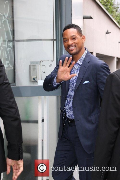 Will Smith is bombarded by fans outside his...