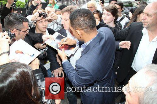 Is bombarded by fans outside his hotel while...