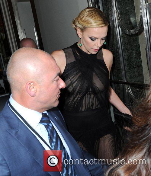 Charlize Theron leaves her hotel to go to...