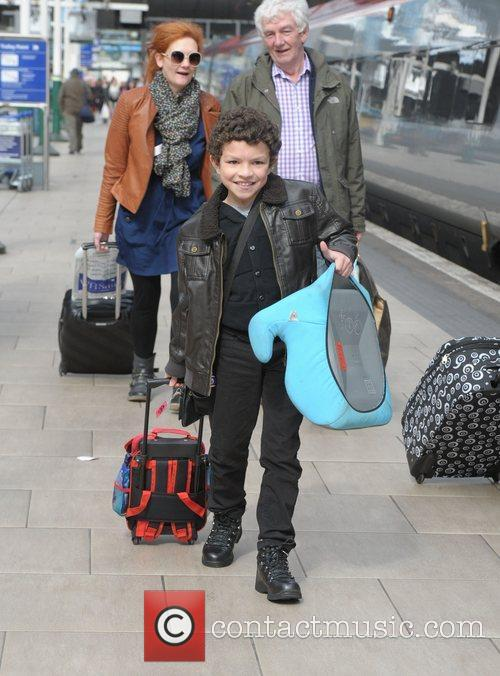 Alex Bain boards a train at Manchester Piccadilly...