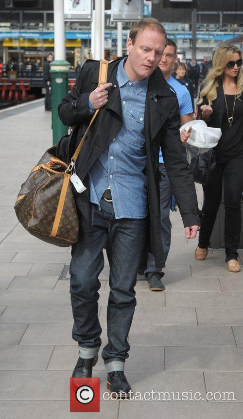 Antony Cotton boards a train at Manchester Piccadilly...