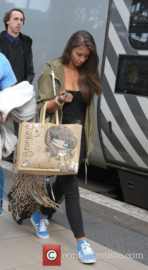 Brooke Vincent boards a train at Manchester Piccadilly...