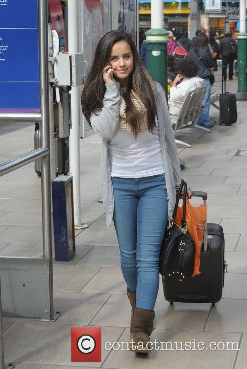 Georgia May Foote boards a train at Manchester...