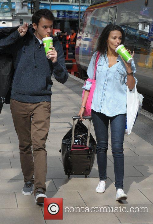 Michelle Keegan and her brother board a train...
