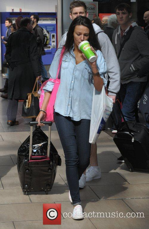 Michelle Keegan minus her engagement ring, boards a...