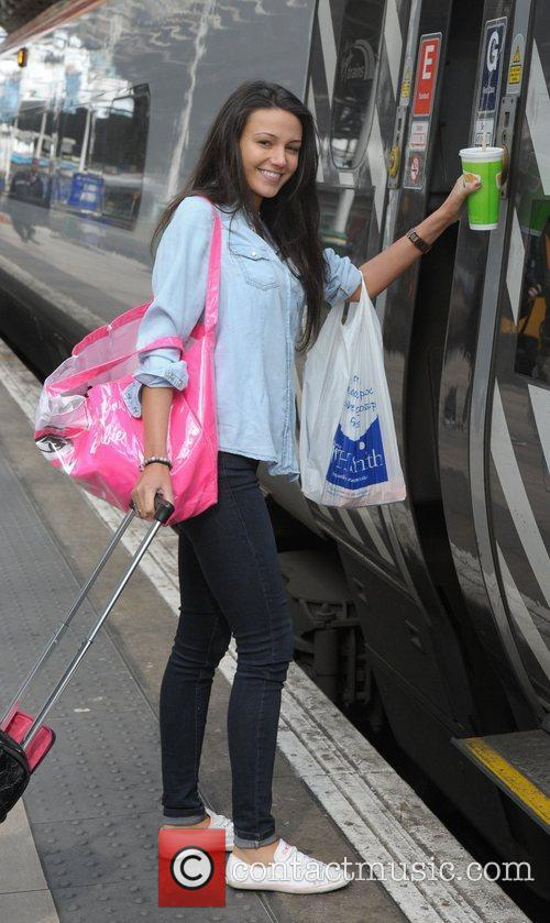 Minus her engagement ring, boards a train at...