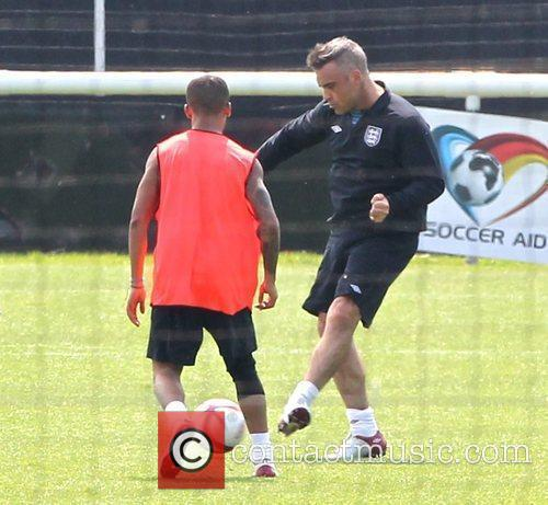 Aston Merrygold and Robbie Williams Celebrities training for...