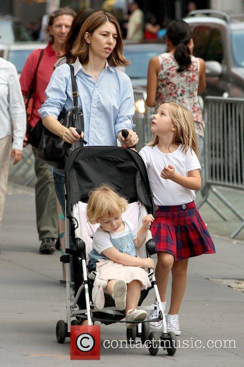 Sofia Coppola walking in Soho with her two...