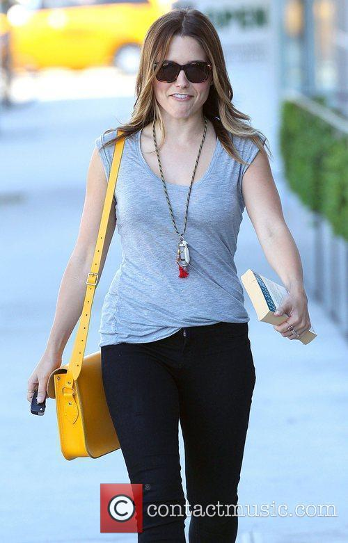 Sophia Bush carries a copy of the book...