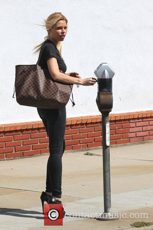 Sophie Monk feeding a parking meter outside The...