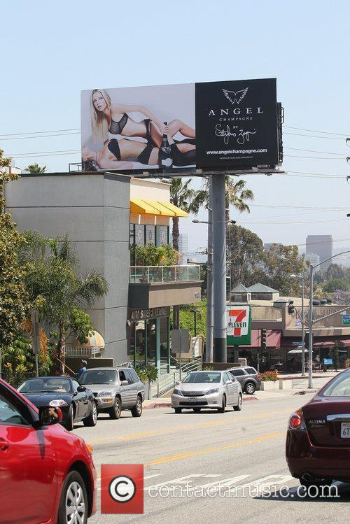 Appears in a billboard campaign for 'Angel Champagne'...