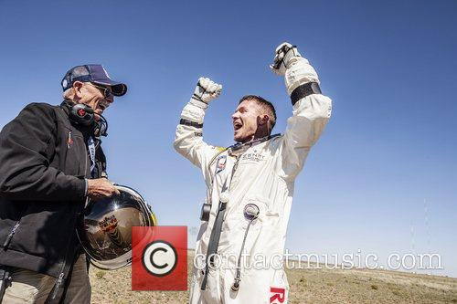 Celebrates after successfully completing the final manned flight...